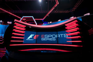 a shot of the gfinity arean F1 Esports series studio lighting and commentator desk